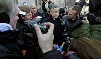 New York Assembly Speaker Sheldon Silver is surrounded by reporters as he leaves Federal court, Thursday. Mr. Silver, who was one of the most powerful men in Albany for more than two decades, was arrested Thursday on public corruption charges.