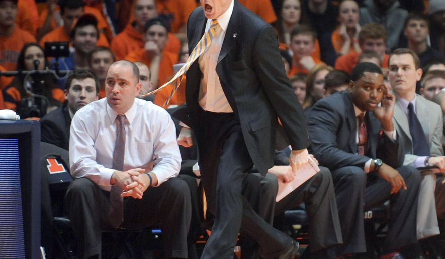 Illinois coach John Groce calls out to a referee during the second half against Purdue in an NCAA college basketball game Wednesday, Jan. 21, 2015, in Champaign, Ill. Illinois won 66-57. (AP Photo/Heather Coit)