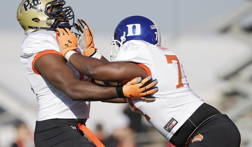Duke offensive lineman Laken Tomlinson (77) blocks Pittsburgh offensive lineman T.J. Clemmings (68) during NCAA college football practice for the Senior Bowl, Wednesday, Jan. 21, 2015, at Ladd-Peebles Stadium in Mobile, Ala. (AP Photo/Brynn Anderson)