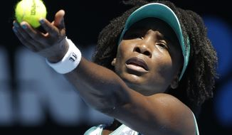 Venus Williams of the U.S. serves to compatriot Lauren Davis during their second round match at the Australian Open tennis championship in Melbourne, Australia, Thursday, Jan. 22, 2015. (AP Photo/Lee Jin-man)