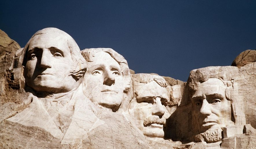 George Washington, Thomas Jefferson, Teddy Roosevelt and Abraham Lincoln are depicted at Mount Rushmore in South Dakota. (AP Photo/File)