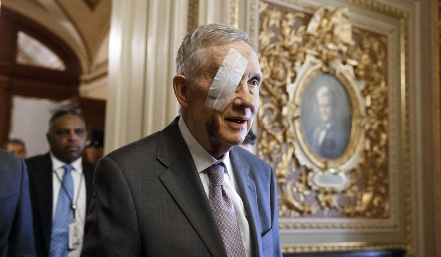 FILE - In this Jan. 20, 2015 file photo, Senate Minority Leader Harry Reid of Nev. walks on Capitol Hill in Washington. Reid's office says he will undergo surgery on his right eye next week following an injury sustained in an exercise accident on New Year's Day. (AP Photo/J. Scott Applewhite, File)