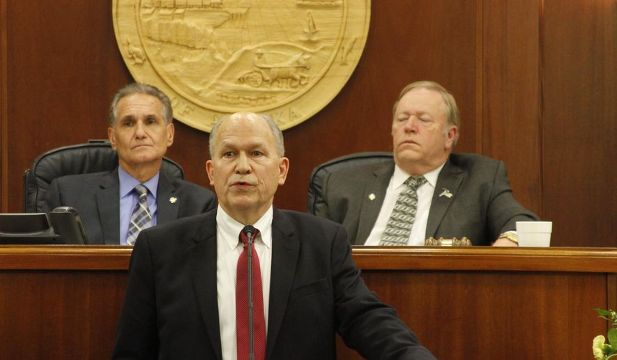 Alaska Gov. Bill Walker gives his first State of the State address Wednesday, Jan. 21, 2015, in Juneau, Alaska. Walker called on Alaskans to pull together, and not panic, as the state faces multibillion-dollar budget deficits amid a fall in oil prices. (AP Photo/Mark Thiessen)
