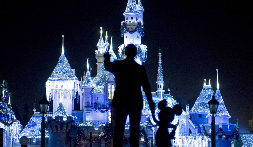 "This Nov. 20, 2009, photo shows Sleeping Beauty's Castle in winter dress with the iconic ""Partners"" statue featuring images of Walt Disney and Mickey Mouse in the foreground, at Disneyland in Anaheim, Calif. (AP Photo/The Orange County Register, H. Lorren Au Jr., File)"