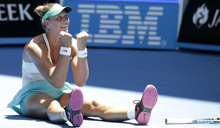 Yanina Wickmayer of Belgium celebrates after defeating Sara Errani of Italy during their third round match at the Australian Open tennis championship in Melbourne, Australia, Friday, Jan. 23, 2015. (AP Photo/Lee Jin-man)