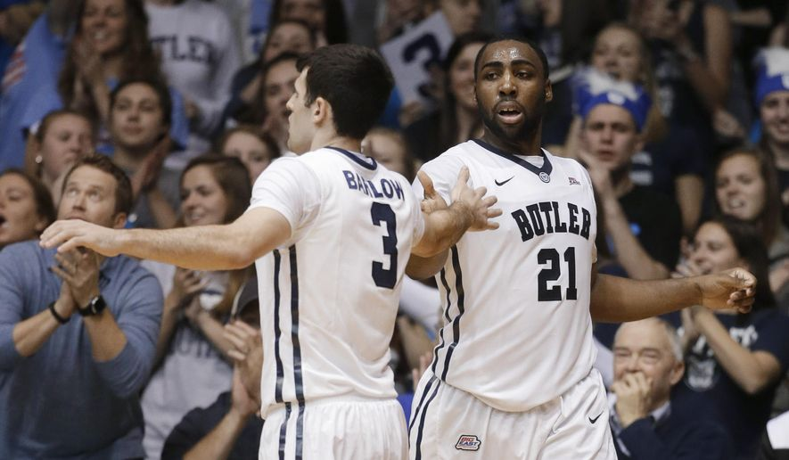 Butler's Roosevelt Jones (21) reacts with Alex Barlow (3) after Jones made a basket and was fouled during the second half of an NCAA college basketball game against Creighton on Wednesday, Jan. 21, 2015, in Indianapolis. Butler defeated Creighton 64-61. (AP Photo/Darron Cummings)
