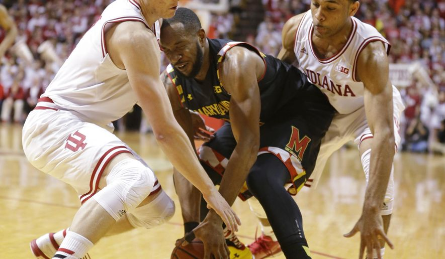 Indiana guard Nick Zeisloft, left, and guard James Blackmon Jr. (1) lock to trap Maryland forward Dez Wells (44) in the first half of an NCAA college basketball game in Bloomington, Ind., Thursday, Jan. 22, 2015. (AP Photo/Michael Conroy)
