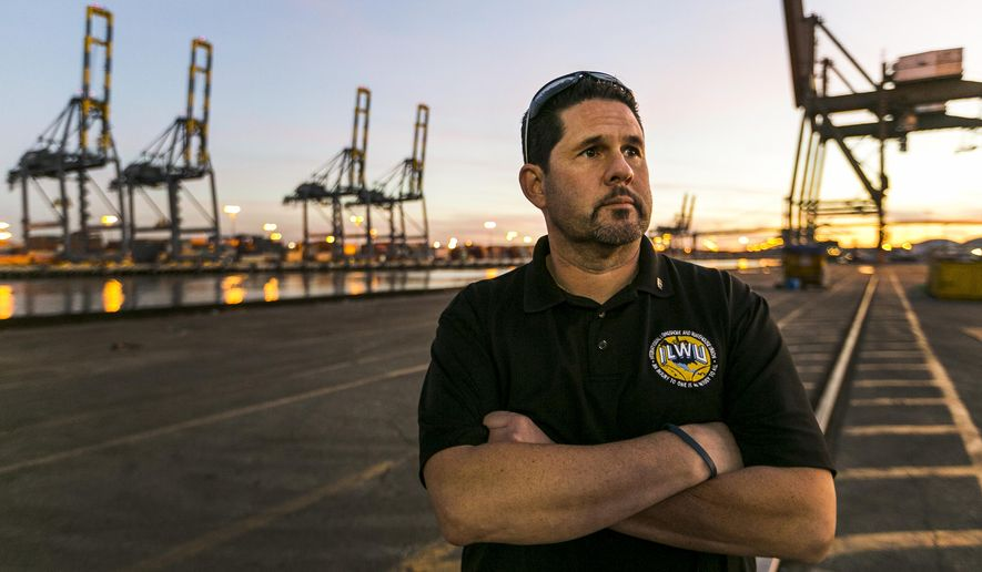 In this Jan. 14, 2015 photo, Bobby Olvera, Jr., president of the union's Local 13 branch, tours an unusually quiet dock at the Port of Los Angeles. Port Negotiators trying to resolve labor strife at West Coast seaports took Thursday, Jan 22, 2015, off, as dockworkers gathered to rally against employers they say are trying to exploit a crisis of cargo congestion at harbors that handle about $1 trillion worth of goods annually. Earlier this month a federal mediator intervened in contract bargaining that began eight months ago but by fall had deteriorated into a blame game, as goods languished on docks. Longshoremen have been working without a contract since the previous one expired in July. (AP Photo/Damian Dovarganes)