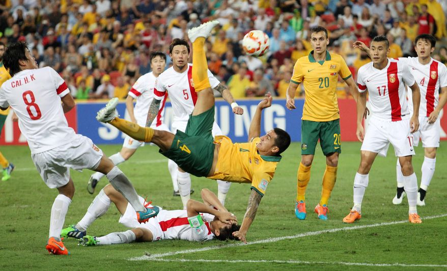 Australia's Tim Cahill performs a overhead kick to score Australia's first goal during the AFC Asia Cup quarterfinal soccer match between China and Australia in Brisbane, Australia, Thursday, Jan. 22, 2015. (AP Photo/Tertius Pickard)