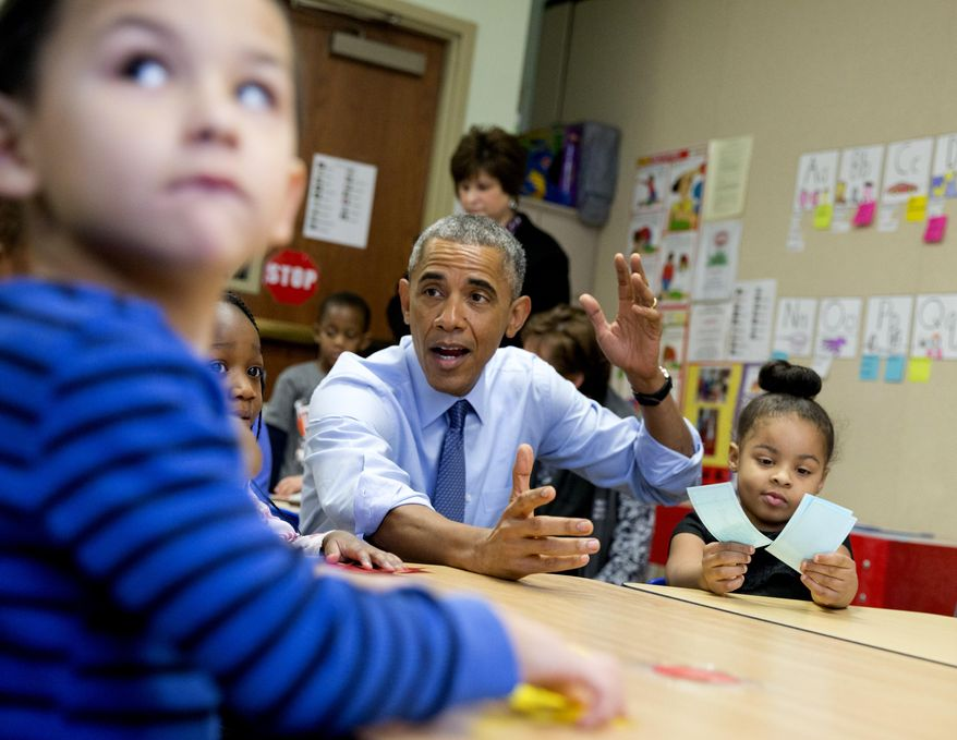 President Barack Obama visits with 3- to 5-year-olds at the Community Children's Center in Lawrence, Kansas, Thursday, Jan. 22, 2015, before speaking about the themes in his State of the Union address. (AP Photo/Carolyn Kaster)