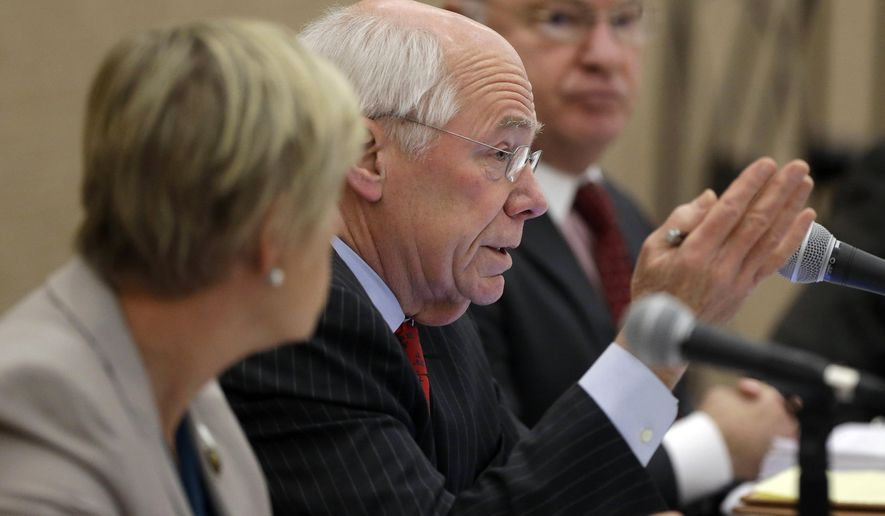 Massachusetts Gaming Commissioner James McHugh, center, speaks during a commission meeting as Gaming Commissioner Gayle Cameron, left, and state Gaming Commission Chair Stephen Crosby, right, look on, Thursday, Jan. 22, 2015, in Boston. Wynn Resorts unveils its proposed new designs for a casino in Everett, Mass., at the meeting. (AP Photo/Steven Senne)