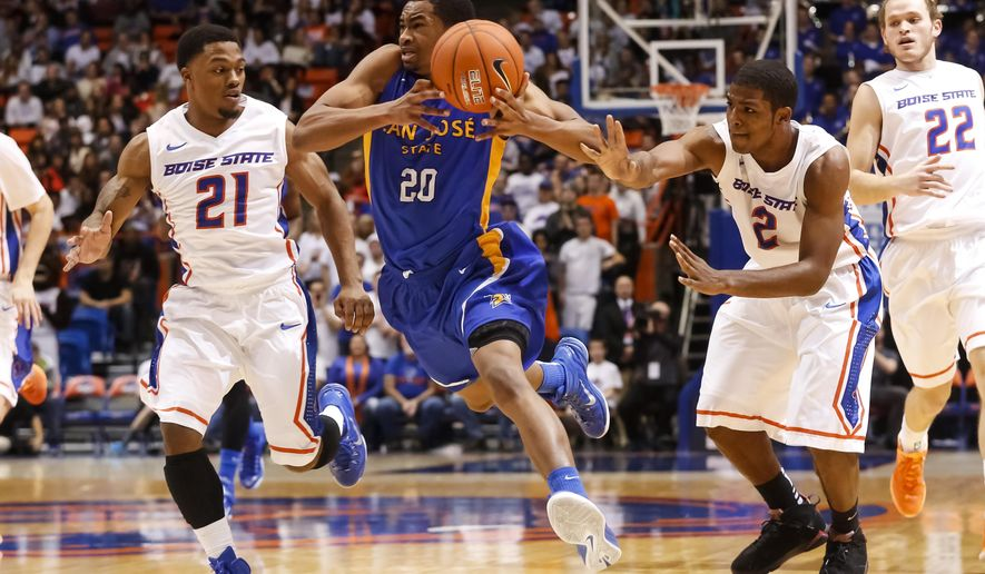 Boise State's Derrick Marks (2, right) knocks the ball out of the hands of San Jose State's Isaac Thornton (20) during the first half of an NCAA college basketball game in Boise, Idaho, on Wednesday, Jan. 21, 2015. (AP Photo/Otto Kitsinger)