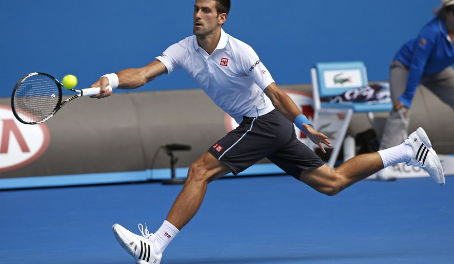 Novak Djokovic of Serbia reaches for a shot to Andrey Kuznetsov of Russia during their second round match at the Australian Open tennis championship in Melbourne, Australia, Thursday, Jan. 22, 2015. (AP Photo/Vincent Thian)