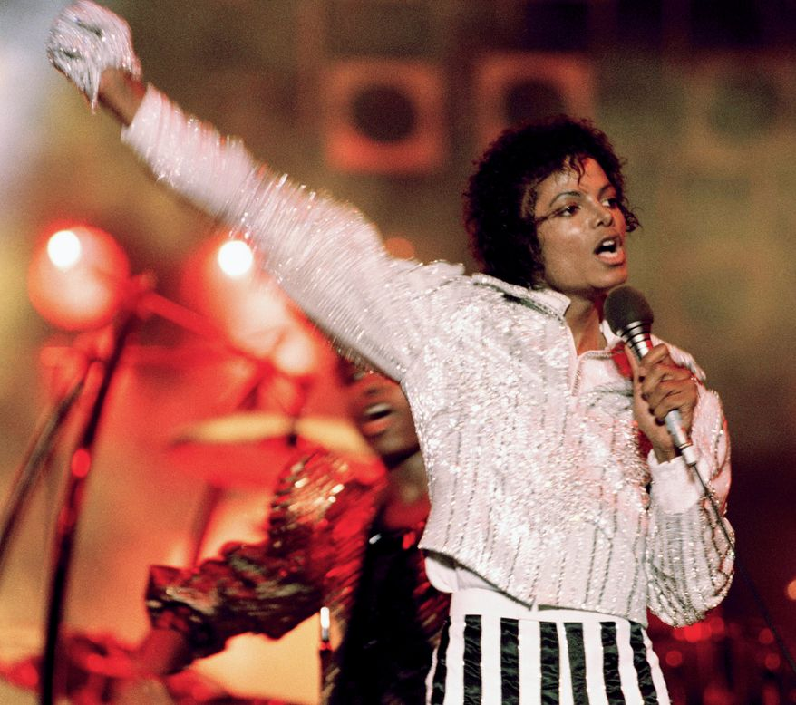 """Singer Michael Jackson, performs during  """"Victory Tour""""  July 1984 in the USA. The King of Pop had his second posthumous album release with Xscape in 2014 which debuted at No. 2 on the charts and helped him earn as much as $140 million. (AP Photo)"""