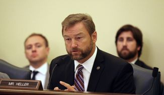 Sen. Dean Heller, R-Nev., questions witnesses at the Senate Commerce, Science and Transportation Subcommittee on Consumer Protection, Product Safety and Insurance on Tuesday, Sept. 16, 2014 on Capitol Hill in Washington. (Associated Press) **FILE**