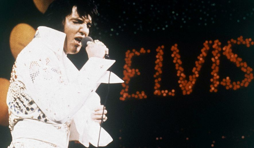 This 1972 file photo shows Elvis Presley, the King of Rock 'n' Roll, during a performance. Digital Domain Media Group announced Wednesday, June 6, 2012 that it is creating a Presley hologram for shows, film, TV and other projects worldwide, including appearances. Digital Domain is linking with Core Media Group, which handles various brands, personalities and properties. The 'King' earns from Graceland admissions, licensing and merchandizing and a Las Vegas Cirque du Soleil show and made $55 million last year. (AP Photo, file)