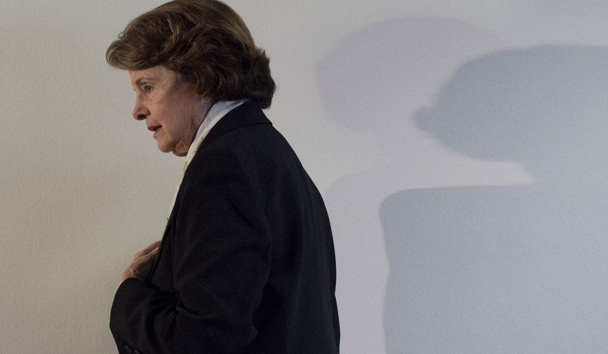 Senate Intelligence Committee Chair Sen. Dianne Feinstein, D-Calif. arrives to make a statement on Capitol Hill in Washington, Thursday, April 3, 2014, after a closed hearing to examine intelligence matters. The Senate Intelligence Committee's expected vote to approve declassifying part of a secret report on Bush-era interrogations of terrorism suspects puts the onus on the CIA and a reluctant White House to speed the release of one of the most definitive accounts about the government's actions after the 9/11 attacks. (AP Photo/Molly Riley)