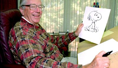 """Cartoonist Charles Schulz holds a drawing of his famous comic strip character """"Snoopy"""" Friday, Sept. 29, 1995, in Santa Rosa, Calif. Schulz, the 73-year-old creator of """"Peanuts,"""" is celebrating his 45th year of penning the round-faced boy Charlie Brown and his dog, Snoopy. Schulz's """"Peanuts,"""" is getting a makeover with a 3-D movie hitting theaters this year. Schulz made $40 Million in 2014. (AP Photo/Ben Margot)"""