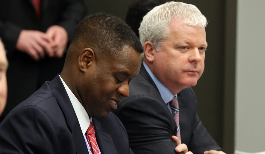 Kevyn Orr, left, and corporate finance consultant Kevin Lavin attend the Atlantic City Summit, Thursday, Jan. 22, 2015, in Atlantic City.  New Jersey Gov. Chris Christie appointed Lavin as the Atlantic City emergency manager and Orr as his assistant. (AP Photo/The Press of Atlantic City, Michael Ein)