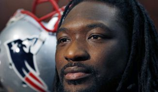 New England Patriots running back LeGarrette Blount listens to a reporter's question at his locker prior to a football team practice in Foxborough, Mass., Thursday, Jan. 22, 2015. (AP Photo/Elise Amendola)