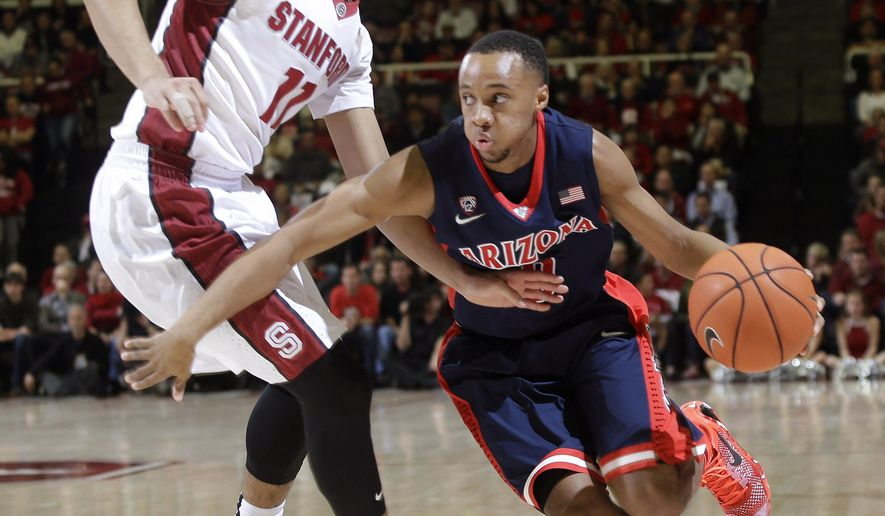 Arizona guard Parker Jackson-Cartwright, right, dribbles next to Stanford's Dorian Pickens (11) during the first half of an NCAA college basketball game Thursday, Jan. 22, 2015, in Stanford, Calif. (AP Photo/Marcio Jose Sanchez)