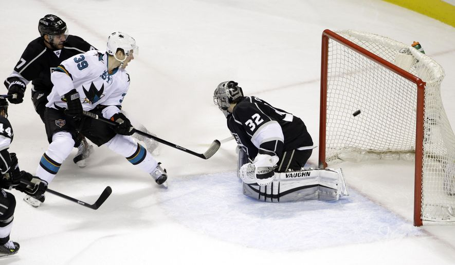 San Jose Sharks' Logan Couture (39) scores past Los Angeles Kings goalie Jonathan Quick (32) during the first period of an NHL hockey game Wednesday, Jan. 21, 2015, in San Jose, Calif. (AP Photo/Marcio Jose Sanchez)