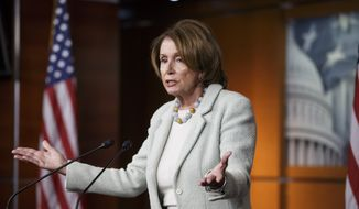 House Minority Leader Nancy Pelosi of Calif. gestures during a news conference on Capitol Hill in Washington, Thursday, Jan. 22, 2015, where she told reporters that she disagrees with House Speaker John Boehner of Ohio, on his invitation to Israeli Prime Minister Benjamin Netanyahu to address Congress without consulting the White House.  (AP Photo/J. Scott Applewhite)