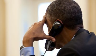 President Barack Obama talks on the phone with European Council President Herman Van Rompuy in the Oval Office, June 13, 2012. (Official White House Photo by Pete Souza)