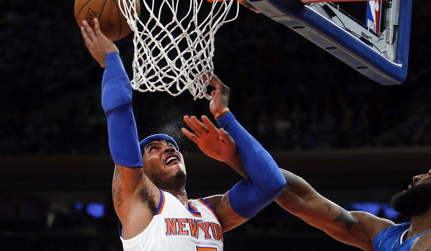 New York Knicks' Carmelo Anthony goes to the basket against Orlando Magic's Kyle O'Quinn during the first quarter of an NBA basketball game Friday, Jan. 23, 2015, in New York. (AP Photo/Jason DeCrow)