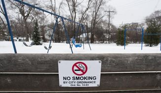 """A """"No Smoking"""" sign is displayed at a park in Ann Arbor, Michigan,  in this Jan. 22, 2015, file photo. In May 2019, St. Johnsbury, Vermont, voted to ban chewing tobacco, smoking tobacco, and vaping on public property within the town. (AP Photo/The Ann Arbor News, Nicole Hester) **FILE**"""