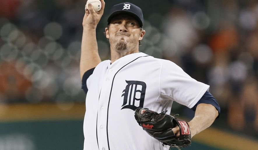 FILE - In this Sept. 25, 2014, file phot, Detroit Tigers relief pitcher Joe Nathan throws against the Minnesota Twins in the the ninth inning of a baseball game in Detroit. It would be an understatement to say Joe Nathan's first season with the Detroit Tigers was a rocky one.  The 40-year-old Nathan remains at the forefront of Detroit's bullpen after posting a 4.81 ERA last year. (AP Photo/Paul Sancya, File)