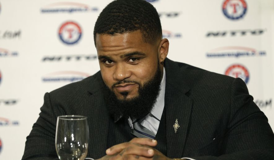 Texas Rangers' Prince Fielder listens to a question during a media availability Friday, Jan. 23, 2015, in Dallas. The Rangers are getting back a slugger and an ace. Fielder played only 42 games in his first season in Texas, and Yu Darvish did not pitch after Aug. 9. (AP Photo/LM Otero)