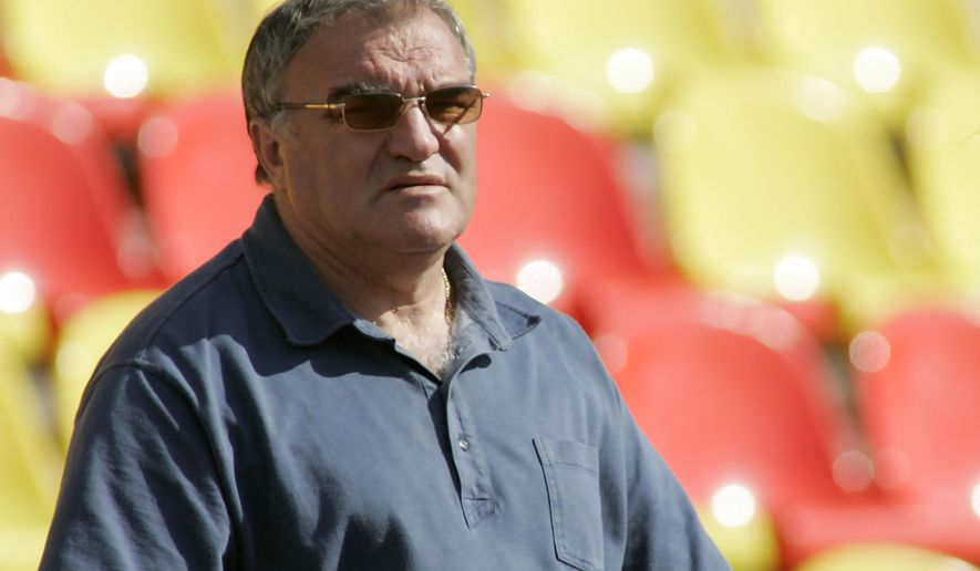 In this photo taken on Tuesday, June  13, 2006 Valentin Maslakov watches an athletics competition in Tula, about 200 kilometers (125 miles) south of Moscow, Russia. Russia's top athletics coach, Valentin Maslakov, resigned Friday amid a series of doping scandals in the country.  (AP Photo/Robert Maksimov)