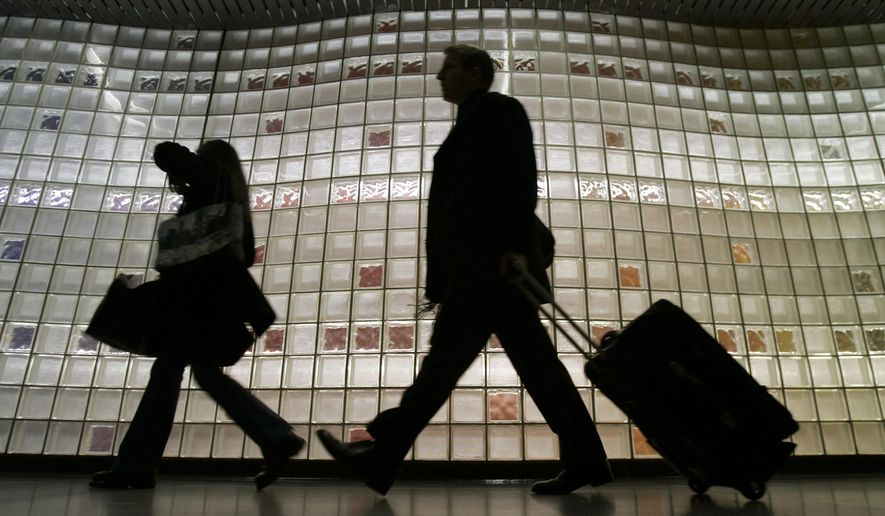 FILE - In this Wednesday, Nov. 23, 2005, file photo, travelers make their way into Chicago's O'Hare International Airport. In-flight catalog SkyMall has filed for bankruptcy, according to reports, Friday, Jan. 23, 2015. (AP Photo/Jeff Roberson, File)