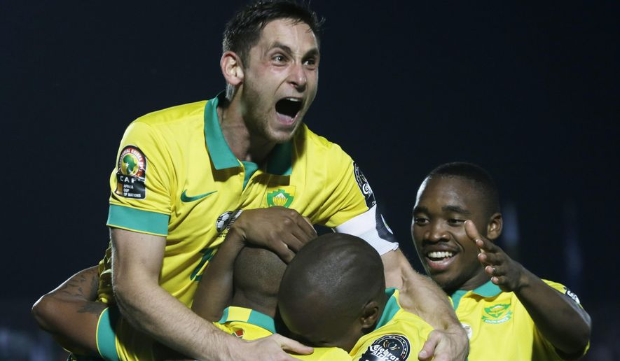 South Africa's Dean Furman, celebrates after a goal during their African Cup of Nations Group C soccer match against Senegal in Mongomo, Equatorial Guinea, Thursday, Jan. 22, 2015. (AP Photo/Themba Hadebe)