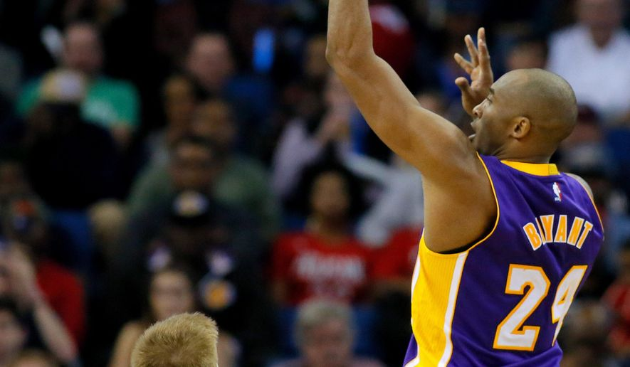 In this Wednesday, Jan. 21, 2015, photo, Los Angeles Lakers guard Kobe Bryant uses his left hand as he makes a shot during the second half of an NBA basketball game against the New Orleans Pelicans in New Orleans. Bryant tore his right rotator cuff in the Lakers' latest defeat, the club announced Thursday. Bryant injured his right shoulder in the second half Wednesday night when he drove the baseline for a two-handed dunk. Bryant returned briefly to the game after the injury, and made this jumper. (AP Photo/Jonathan Bachman)