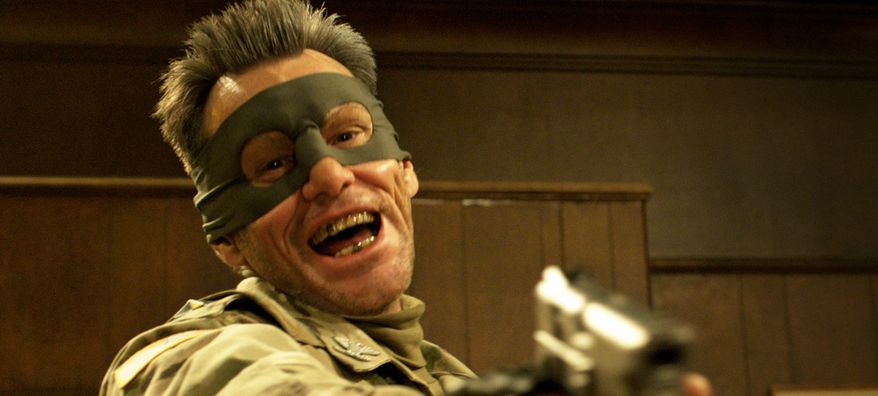 """Jim Carrey in a scene from """"Kick-Ass 2."""" The actor tweeted that he could not support the violence in the 2013 superhero action flick in the wake of the Sandy Hook Elementary School massacre. (AP Photo/Universal Pictures)"""