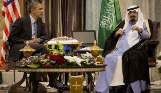 In this March 28, 2014 file photo, U.S. President Barack Obama meets with Saudi King Abdullah about a coalition to tackle the extremist Islamic State group, at Rawdat Khuraim, Saudi Arabia. On early Friday, Jan. 23, 2015, Saudi state TV reported King Abdullah died at the age of 90. (AP Photo/Pablo Martinez Monsivais, File)