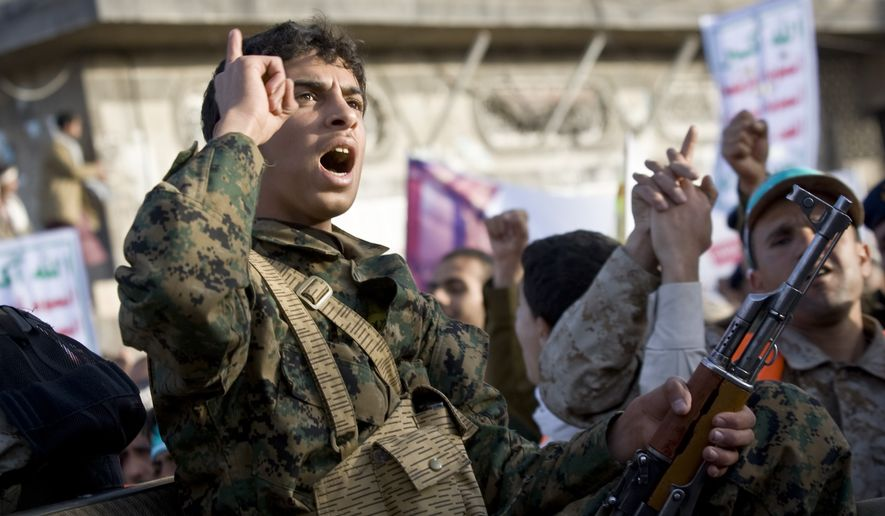 A Houthi Shiite fighter wearing an army uniform chants slogans during a demonstration to show support for his comrades in Sanaa, Yemen, Friday, Jan. 23, 2015. Thousands of protesters demonstrated Friday across Yemen, some supporting the Shiite rebels who seized the capital and others demanding the country's south secede after the nation's president and Cabinet resigned. (AP Photo/Hani Mohammed)