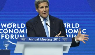 U.S. Secretary of State John Kerry gestures as he speaks during a panel session at the World Economic Forum, in Davos, Switzerland, Friday, Jan. 23, 2015. (AP Photo/Michel Euler)