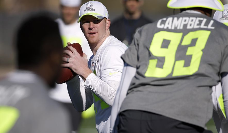 Cincinnati Bengals quarterback Andy Dalton drops back to pass during practice for the NFL Football Pro Bowl Saturday, Jan. 24, 2015, in Scottsdale, Ariz. The game is scheduled to be played Sunday in Phoenix. (AP Photo/Mark Humphrey)