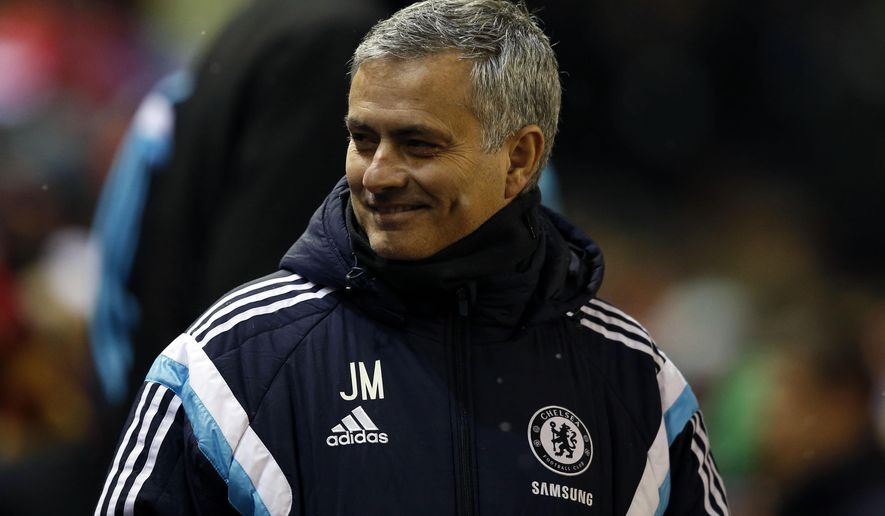 Chelsea's head coach Jose Mourinho smiles before the English League Cup semi-final first leg soccer match between Liverpool and Chelsea at Anfield Stadium, Liverpool, England, Tuesday Jan. 20, 2015. (AP Photo/Jon Super)