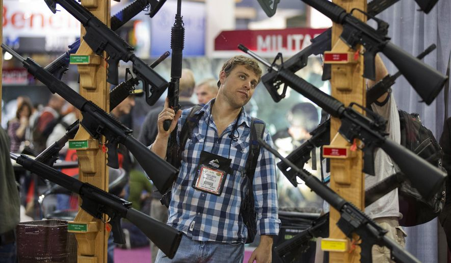 Gun dealers had been steeling for a potential dip after the election of Donald Trump, who proudly championed gun rights during his 2016 campaign against Democrat Hillary Clinton and touted the earliest-ever presidential endorsement from the National Rifle Association. (Associated Press/File)