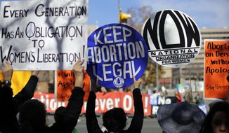 Pro-choice supporters, foreground, try to disrupt pro-life supporters as they march to the Texas Capitol during a Texas Rally for Life, Saturday, Jan. 24, 2015, in Austin, Texas. (AP Photo/Eric Gay)
