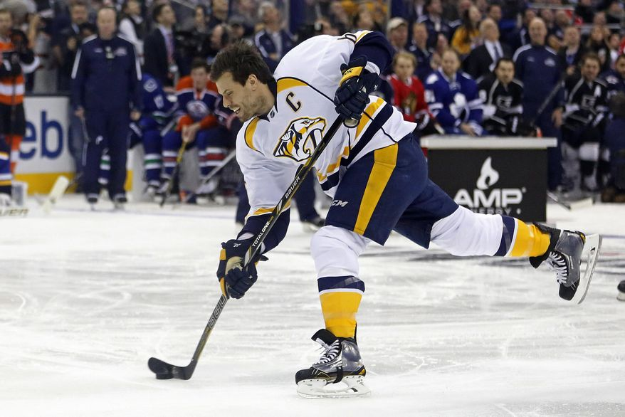 Nashville Predators Shea Weber, of Team Toews, takes a slap shot measured at 108.5 mph to win the hardest shot competition during the NHL All-Star hockey skills competition in Columbus, Ohio, Saturday, Jan. 24, 2015. (AP Photo/Gene J. Puskar)