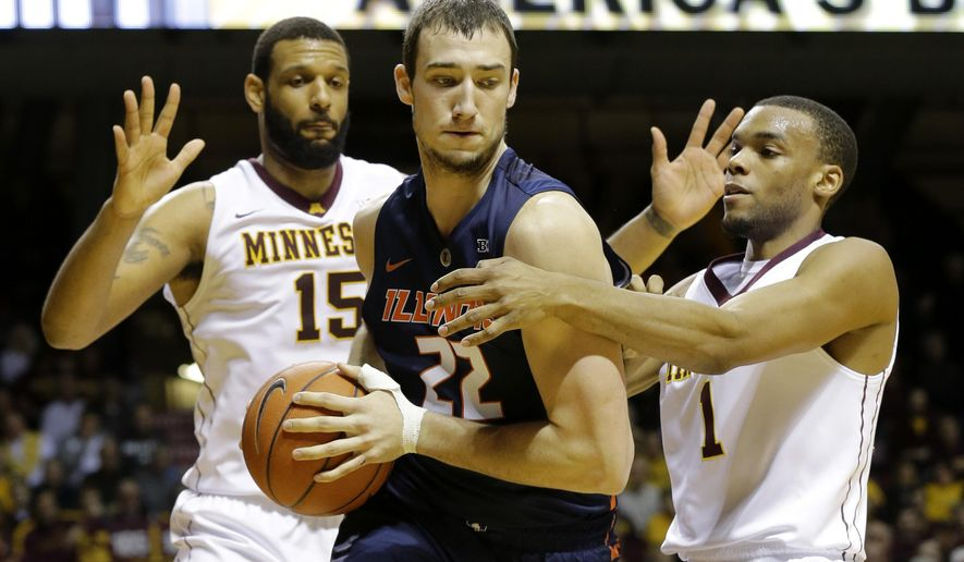 Illinois center Maverick Morgan (22) is trapped by Minnesota forward Maurice Walker (15) and guard Andre Hollins (1) during the first half of an NCAA college basketball game in Minneapolis, Saturday, Jan. 24, 2015. (AP Photo/Ann Heisenfelt)