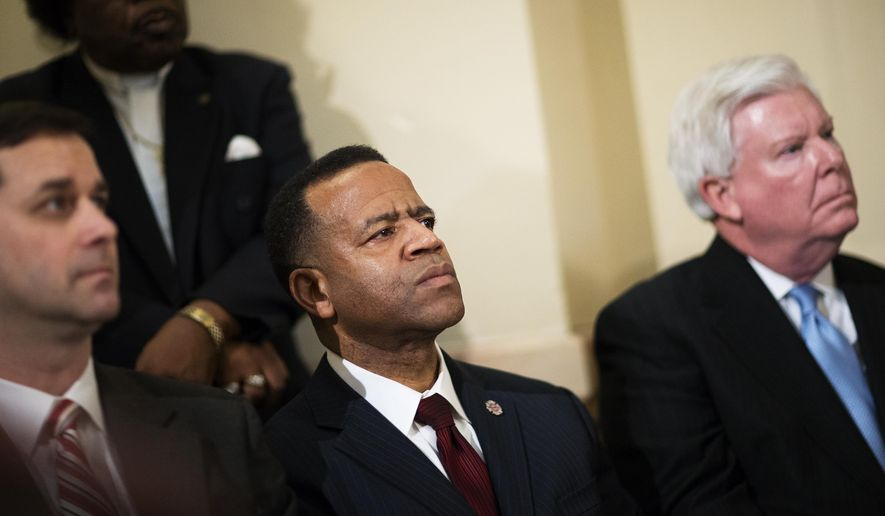 Former Atlanta Fire Chief Kelvin Cochran, second from left, listens during a rally by religious groups supporting Mr. Cochran following his termination, in this Tuesday, Jan. 13, 2015, file photo. (AP Photo/David Goldman) **FILE**