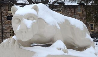 The Nittany Lion statute at the Penn State Hazleton Campus in Hazleton Pa., is covered in snow Friday Jan. 23, 2015.  The National Weather Service says a messy mix of rain, snow and sleet is bearing down on the Northeast for the first significant winter storm of the season to affect the Interstate 95 corridor. (AP Photo/Hazleton Standard-Speaker, Eric Conover)