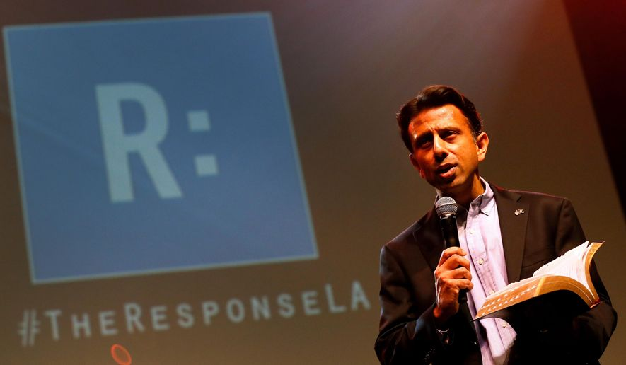 Louisiana Gov. Bobby Jindal reads from the bible during a prayer rally, Saturday, Jan. 24, 2015, in Baton Rouge, La. Mr. Jindal continued to court Christian conservatives for a possible presidential campaign with a headlining appearance at an all-day prayer rally hosted by the American Family Association. (AP Photo/Jonathan Bachman)