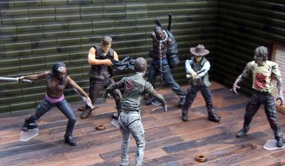 McFarlane Toys' ode to The Walking Dead includes  buildable, 2-inch tall mini-figures of humans such as Michonne, Daryl Dixon and Carl as well as walkers in its Blind Bag assortment. (Photograph by Joseph Szadkowski / The Washington Times)